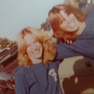 Crystal and I at a high school football game, around 1979
